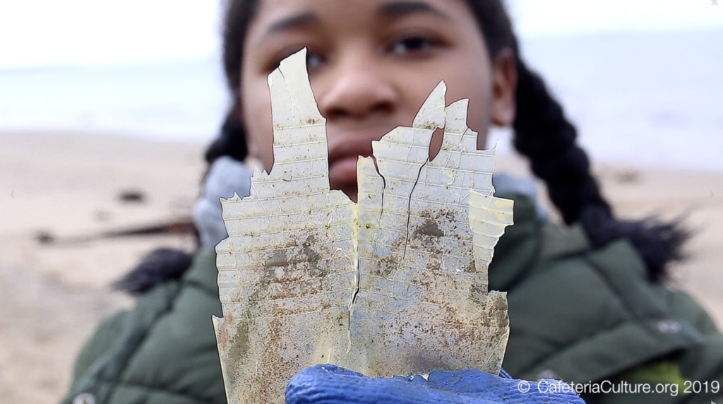 Screen Grab#1 Girl holding plastic